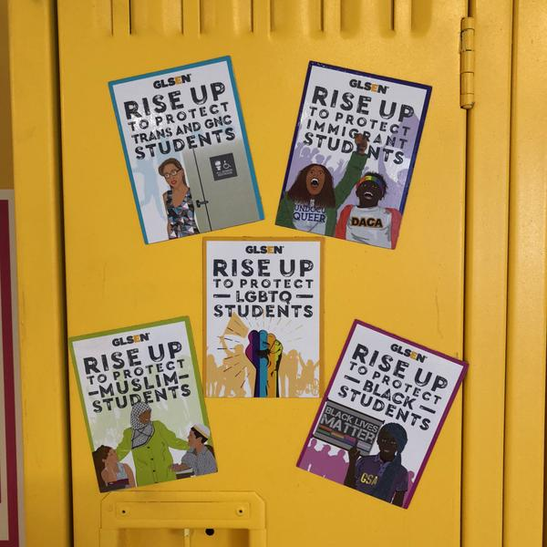 Illustrated GLSEN Rise Up magnets stick to a bright yellow locker. From left to right, they read: Rise up to protect trans and GNC students; rise up to protect immigrant students; rise up to protect Muslim students; rise upt o protect LGBTQ students; rise up to protect black students. The matching colorful illustrations from left to right are: a woman exits an all-gender restroom; two students chant at a protest, one raises her fist, the other wears a rainbow bandana, their shirts say Undocu Queer and DACA