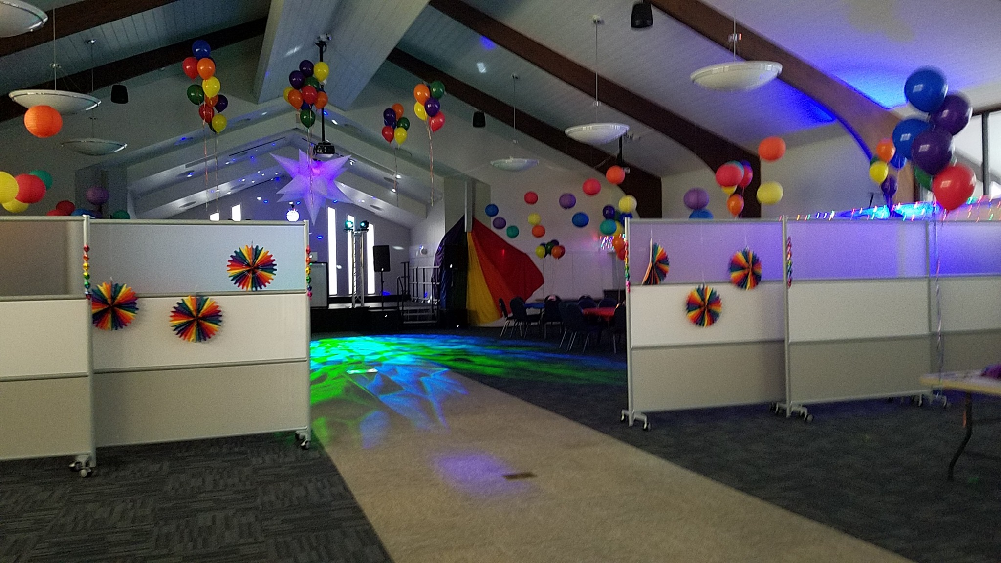 Open room with pride decorations and dim lighting