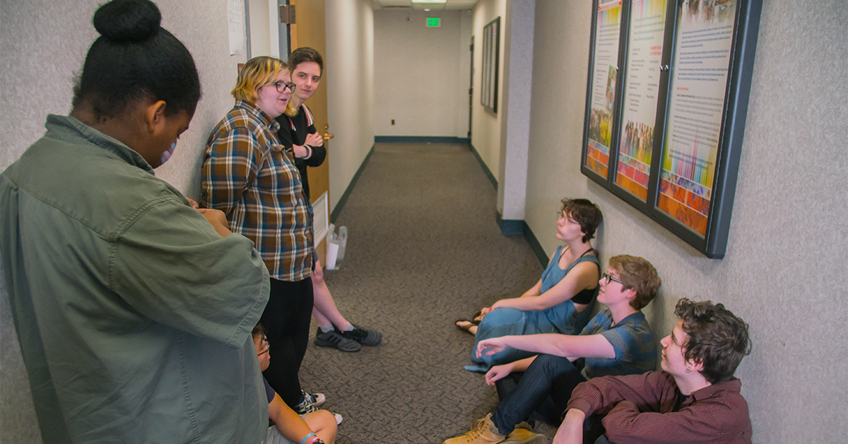 A photo of students in a hallway talking