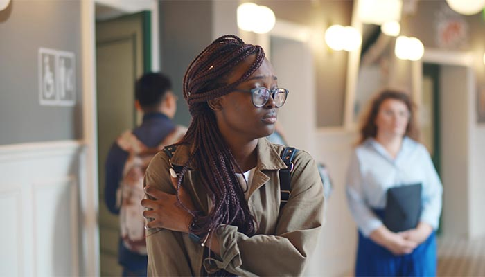 Student standing in the hallway