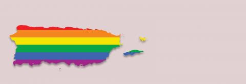 A rainbow flag in the shape of Puerto Rico