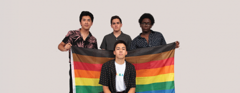 GLSEN Students Holding Rainbow Flag with Black and Brown stripe